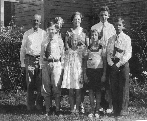 Family picture; l-to-r: Harold, James, Mary, Elizabeth, Aunt Bess, Betty Jeanne, Harold, and Sidney, circa 1932